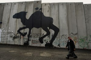 Banksy graffiti on the West Bank security wall
