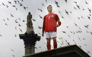 A wax effigy of David Beckham stands on an empty plinth in Trafalgar Square