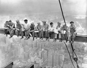 September 29 1932, Manhattan, US: Construction workers eat their lunches atop a steel beam 800 feet above ground