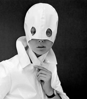 Fashion photograph, 1960s.  A model wearing a white mask