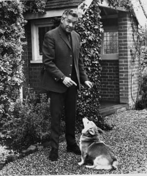 Paul Scofield poses with his dog in the yard of then home in Balcombe, England