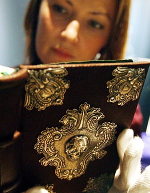 A Sotheby's employee gets a sneal preview of The Tale of Beedle the Bard
