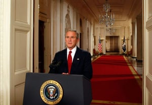 George Bush poses for photographers moments after speaking to the nation about the current financial crisis
