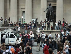 UnassignedThe presence of news media attract onlookers in front of Federal Hall, during coverage of nearby New York Stock Exchange