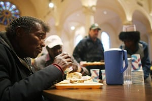 April 29 2008: A man eats a free lunch at the Holy Apostles Soup Kitchen in New York City