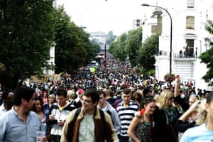 Revellers fill the streets of west London for the Notting Hill carnival