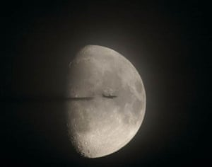 Plane passing in front of the moon