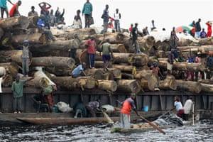 A log barge travels down the Lukenie River to Kinshasa