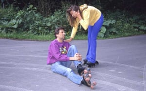 An injured rollerskater and a girl on rollerblades