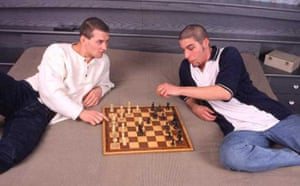 Two men enjoy a game of chess