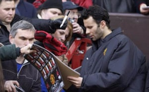 Ryan Giggs signs autographs