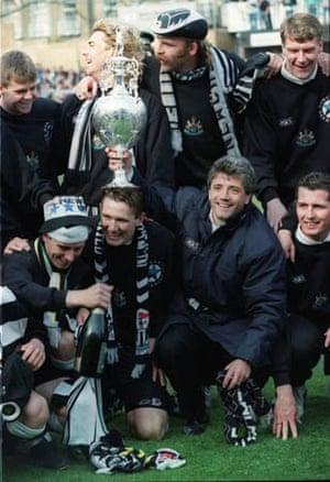 Manager Kevin Keegan celebrates with players after winning the Division One Championship Cup