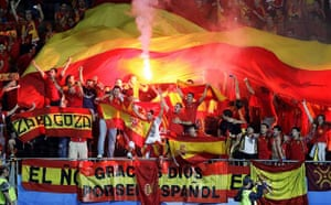Spanish supporters light a flare