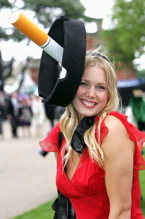 A racegoer on Ladies' Day at the Berkshire racecourse