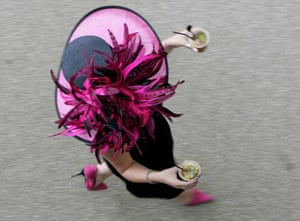 A woman carries drinks to the Royal enclosure
