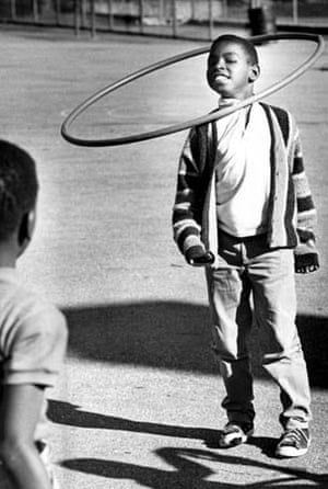 A boy with a hula hoop in the 1960's