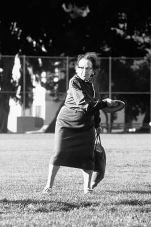 A woman plays with a frisbee