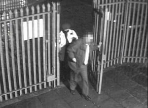 1.21am Kidnapped manager Colin Dixon is led into the depot