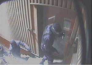 1.29am Three masked men at the depot's front door