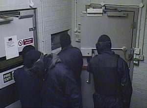 1.29am Four masked men in the lobby area