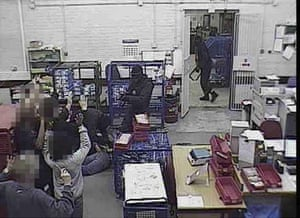 1.32am Members of staff are held at gunpoint while the robbers search the depot for money