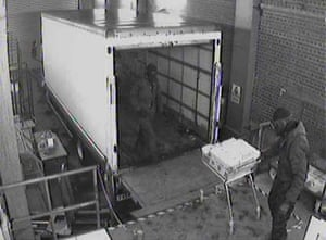 2.05am A shopping trolley is used to load money onto the lorry
