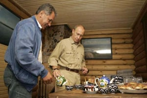 Putin serves tea to Sergei Shoigu at the fortress Por-Bazhyn on Tere-Khol Lake