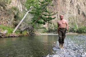Putin walking near the Khemchik river