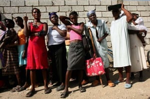 Residents wait for free medical attention outside the Saint Spirit medical centre