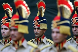 Officers of the Delhi police force stand to attention