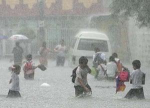Schoolchildren brave strong rains and floods