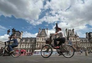 People ride 'Velib' bicycles
