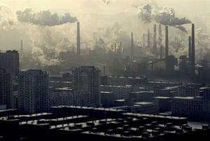Steel mills blowing smoke over residential buildings