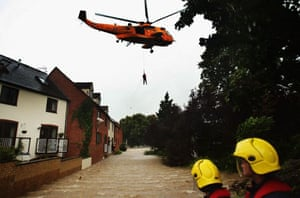 A local resident is air lifted from their home