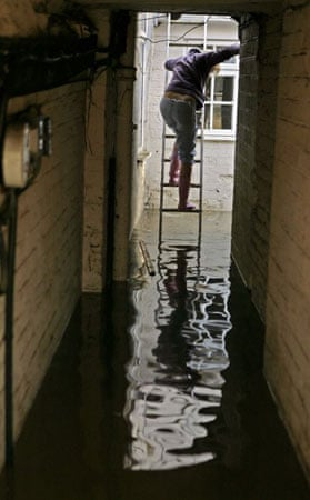 A local resident attempts to re-enter her house in Evesham