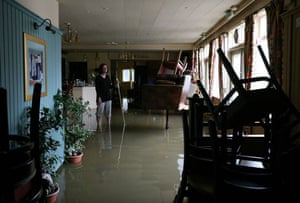 Amanda Green, landlady of the flooded Canterbury Arms in Tewkesbury, surveys the damage