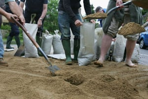 Residents of the village of Standlake fill sandbags