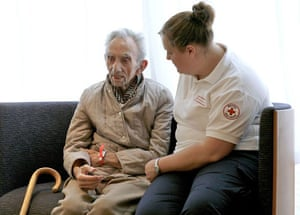 A member of the British Red Cross talks to a flooding victim
