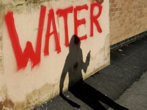 The shadow of a woman collecting bottled water