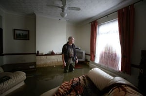 Norman Aitken surveys the damage to his home