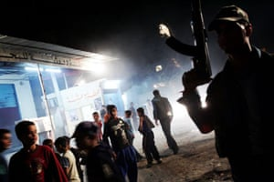 A PLO gunman patrols the streets