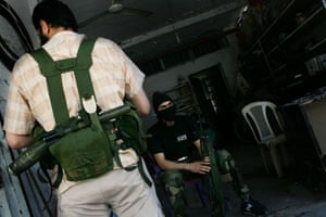Islamist fighters from the Palestinian jihadi group Jund al-Sham