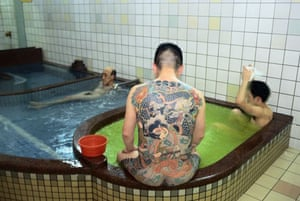 A member of the Yakuza in a public bath