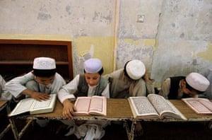 Boys read the Quran at a madrassa