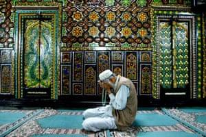 A Kashmiri muslim prays inside the shrine of Shah Hamdan