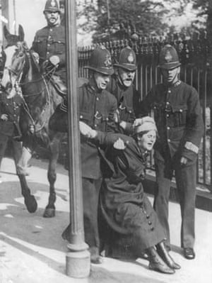 A woman being restrained by police