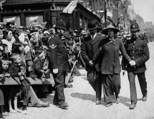 A suffragette under arrest in Dundee