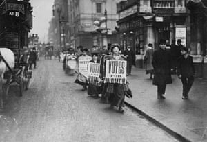 Women advertise a suffragettes' meeting