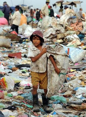 A Cambodian girl scavenges on a dump