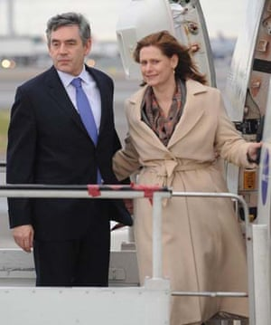 Gordon Brown and his wife at Heathrow Airport